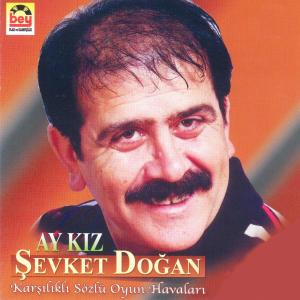�EVKET DO�AN-Ay K�z